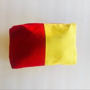 GIVENCHY • red & yellow logo makeup bag